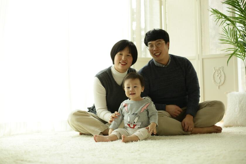 SangMin Lee today with his wife Shaem Song and their son Seojin.