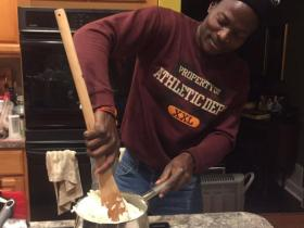 <p>Wyclif Ochieng makes Kenyan staple food ugali for his host IVEP family in Pennsylvania. </p>